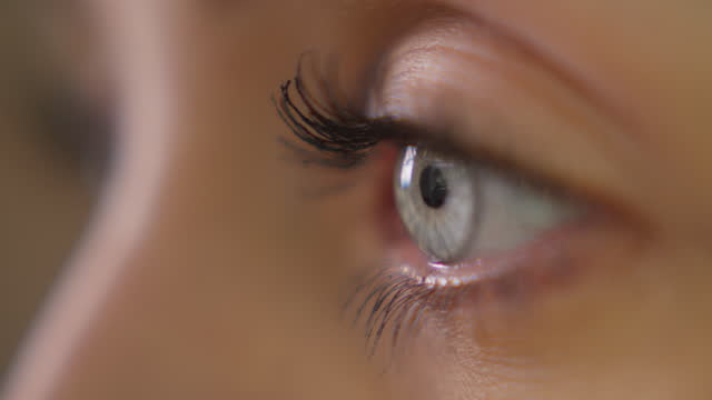 extreme closeup on bright blue eye. beautiful female face - human eye stock videos & royalty-free footage