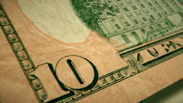 extreme closeup showing the engraving detail on the back of the u.s $10 dollar bill - banconota da 10 dollari statunitensi video stock e b–roll