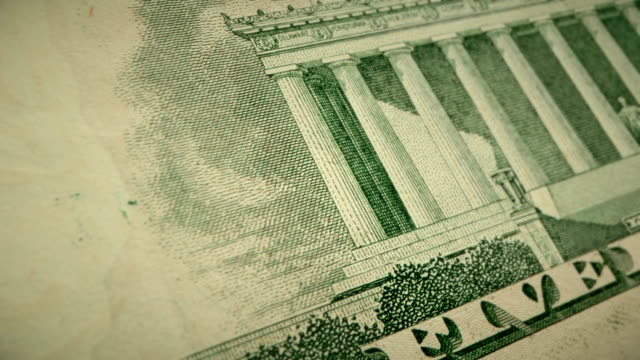extreme closeup showing the engraving detail on the back of the u.s $5 dollar bill - five dollar bill stock videos & royalty-free footage