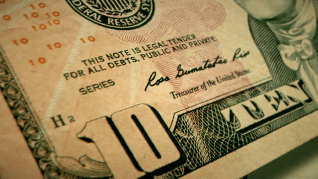 extreme closeup showing the engraving detail on the front of the u.s $10 dollar bill - banconota da 10 dollari statunitensi video stock e b–roll