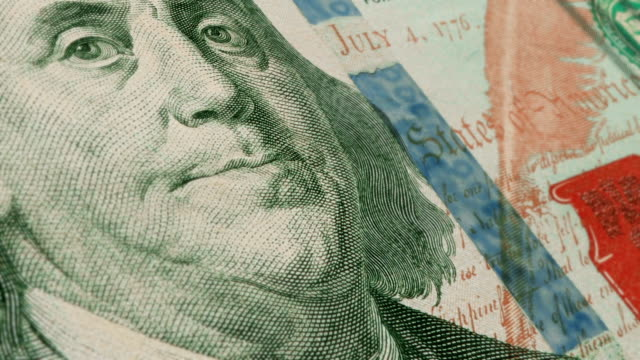 extreme closeup showing the engraving detail on the front of the u.s $100 dollar bill - benjamin franklin video stock e b–roll