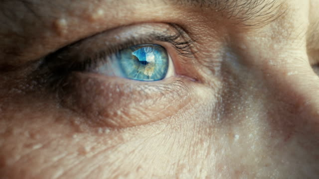 extreme close-up to a man's eye looking away - blinking stock videos & royalty-free footage