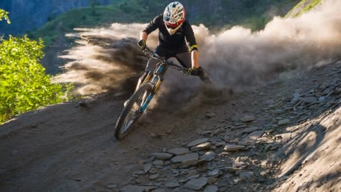 extreme downhill mountain biker on dirt road making a turn, leaving a cloud of dust behind - extreme sports stock videos & royalty-free footage