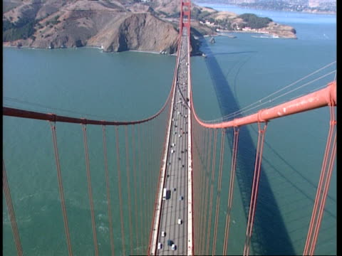 WA Extreme high angle, looking down from top of tower to lanes of traffic on Golden Gate bridge, San Francisco