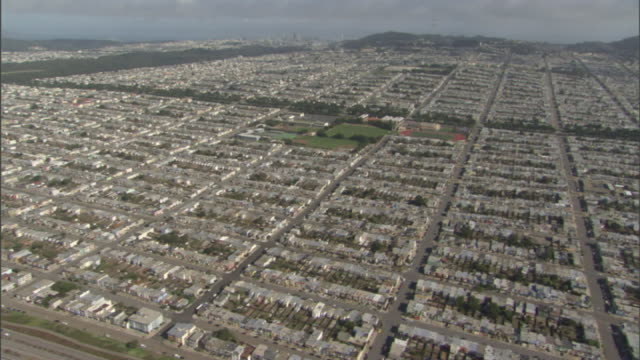 Extreme Long Shot aerial tracking-left - Neighborhoods are laid out in a square grid pattern. / San Francisco, California, USA