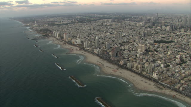 extreme long shot aerial tracking-left - the city of haifa sprawls along the israeli coastline. / haifa, israel - haifa video stock e b–roll