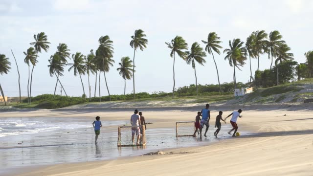 Extreme Long Shot children playing football on the beach General views from a beach in Natal Brazil shot on December 8th 2014 Natal is located on the...