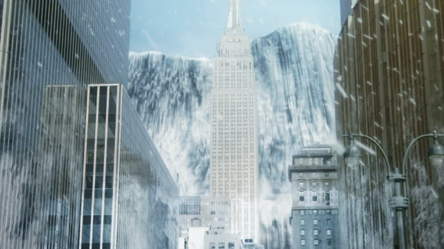 Extreme Long Shot crane hand-held - A glacier slides toward the Empire State Building in a computer-generated animation. / New York City, New York, USA