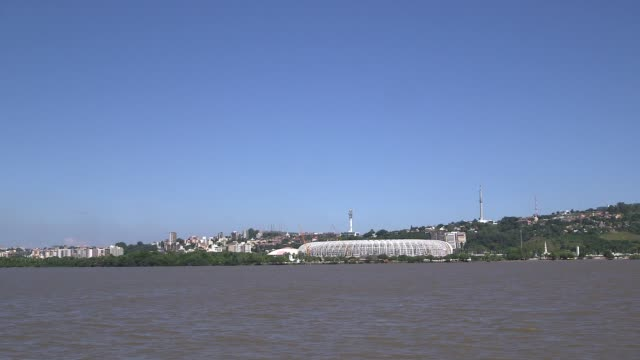extreme long shot estadio beirario in porto alegre view form lagoa dos patos home to the sport club internacional one of brazil's biggest clubs the... - porto alegre stock-videos und b-roll-filmmaterial