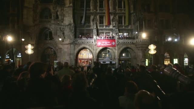 Extreme long shot of Bayern Muenchen team as they celebrate the German championship title on the town hall balcony at Marienplatz on May 11 2013 in...
