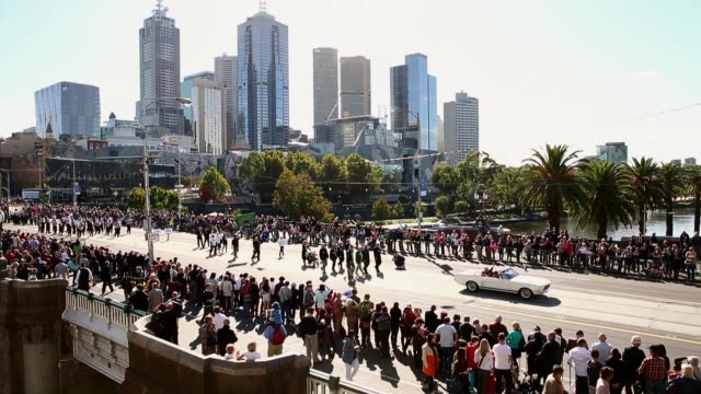 Extreme long shot of marching parade pan from left to right Australians Commemorate ANZAC Day on April 25 2013 in Various Cities Australia Extreme...