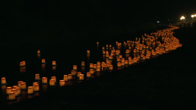 extreme long shot of numerous orange-colored floating lanterns - lantern stock videos & royalty-free footage