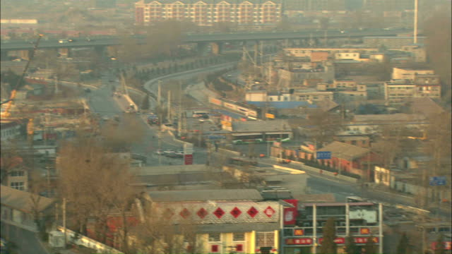 Extreme Long Shot pan-right - A hazy sky surrounds the city of Beijing, China./Beijing, China