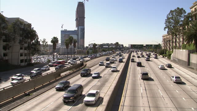 extreme long shot static - traffic streams along los angeles' freeways. / los angeles, california, usa - establishing shot stock videos & royalty-free footage