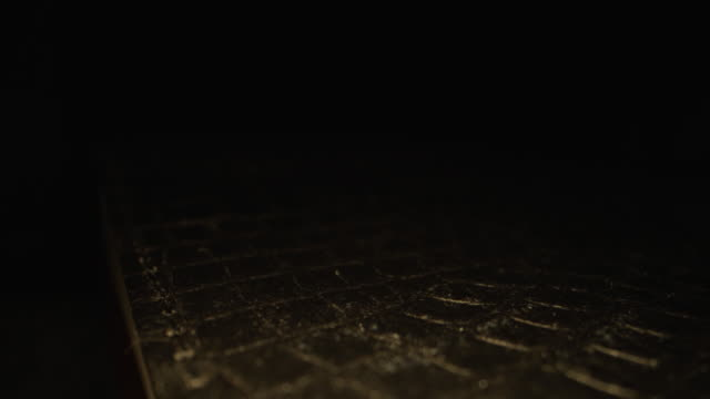extreme macro close-up moving slider shot of holy bible cover texture pattern book of the word of god on a dark background with unique lighting - book cover stock videos & royalty-free footage