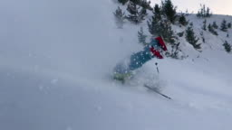 Extreme male skier riding off piste jumps and crashes into the fresh powder snow