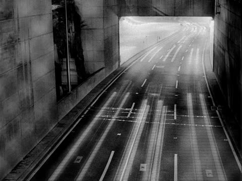 extreme rapid motion traffic: streaks of headlights from traffic traveling out of tunnel & down one-way road below. - one way stock videos & royalty-free footage