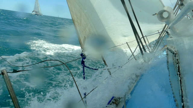 extreme sailing races in a storm (slow motion) - sailing boat stock videos and b-roll footage