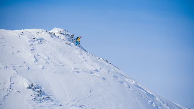 extreme skiing on powder snow in backcountry - downhill skiing stock videos & royalty-free footage