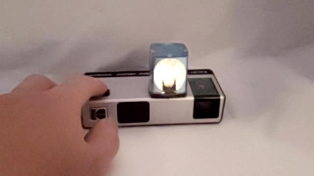 extreme slow motion of vintage magicube flash cube firing atop a kodak instamatic camera on a white background september 26 2019 - white background stock videos & royalty-free footage
