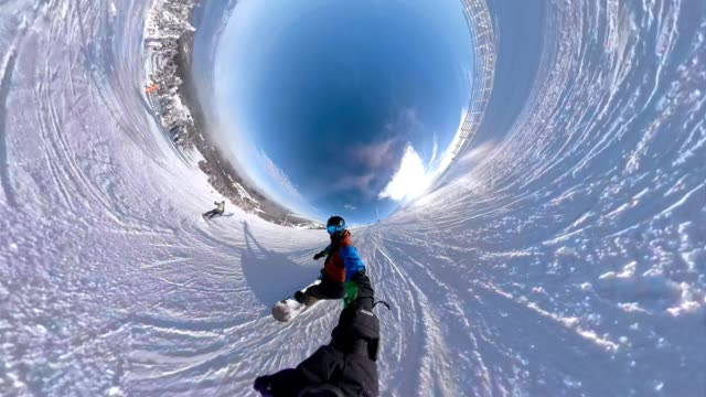extreme snowboarder holding a monopod while snowboarding - exhilaration stock videos & royalty-free footage
