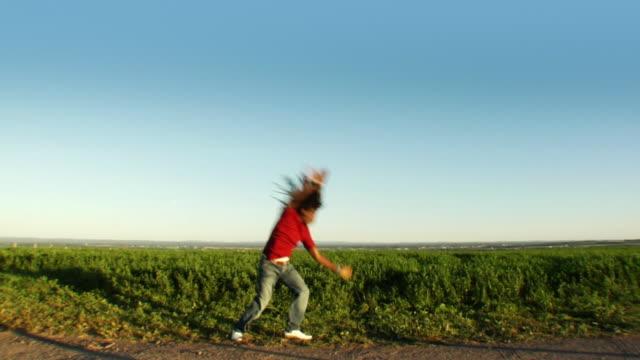 extreme spinning rasta boy - cartwheel stock videos & royalty-free footage
