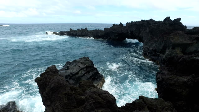 extreme volcanic terrain surrounding bay of rough water - maui stock videos & royalty-free footage