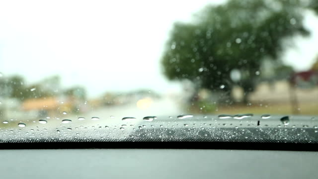 Extreme Weather. Heavy rain while driving vehicle. Windshield.