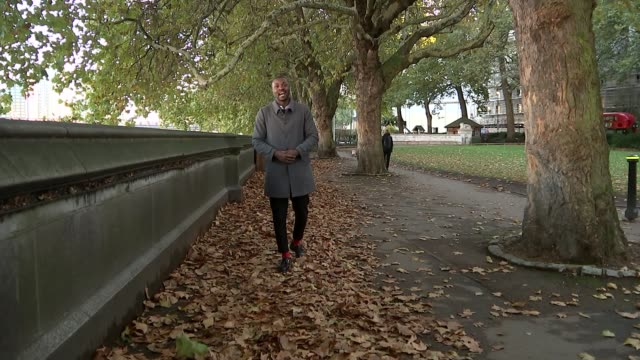 Extreme weather in UK has become more frequent due to climate change UK London Westminster Baroness Julia Brown interview / Autumn leaves around...