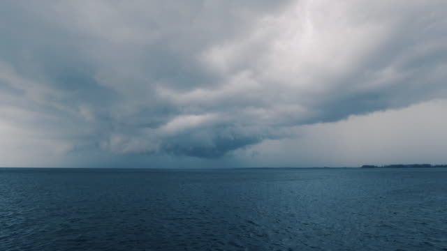 extreme weather typhoon tornado cyclone hurricane supercell forming at sea - moody sky stock videos & royalty-free footage