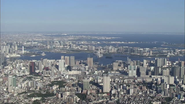 stockvideo's en b-roll-footage met extreme wide angle aerial view of tokyo bay viewed from ota ward tokyo during the day - veerboothaven