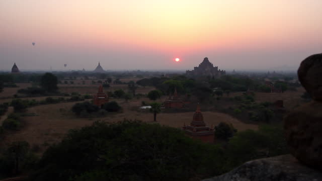 extreme wide shot of the buddhist temples in bagan at sunrise - theravada stock videos & royalty-free footage
