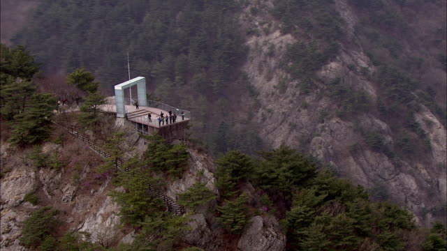 extreme zoom out aerial view of apsan mountain at daegu - daegu stock videos and b-roll footage