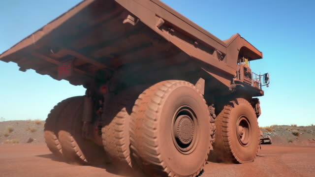 extremely large trucks transport ore around a mine - mining stock videos & royalty-free footage