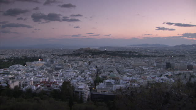 extremely wide, elevated pan over athens' rooftops stretching into the distance, greece. - acropolis athens stock videos and b-roll footage