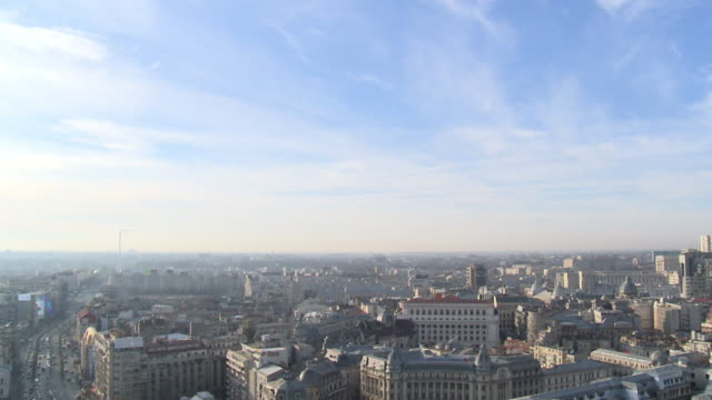 Extremely wide pan over the city of Bucharest on a sunny day, Romania.