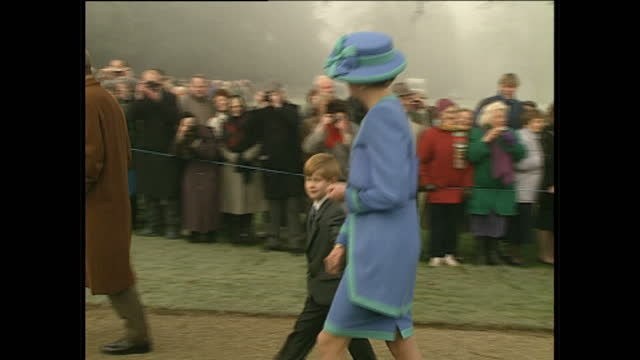 Extrerior shots of Prince Philip and Prince Charles walking together Princess Diana with Prince William Prince Andrew with Fergie and Prince Edward...