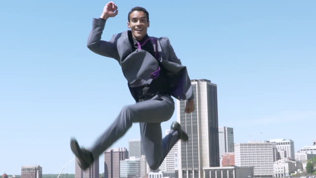 exuberant young businessman jumping