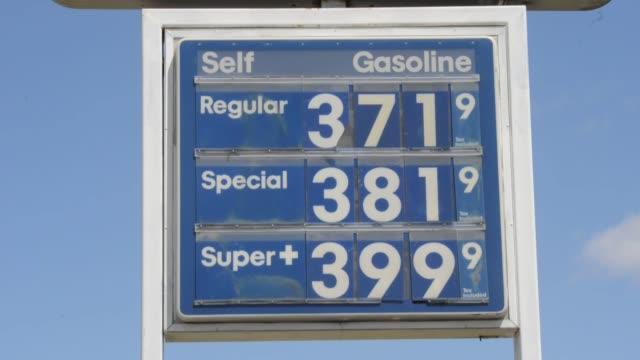 exxon mobil signage gas station gas pumps gas prices exxon mobil gas station on april 26 2013 in edwards california - exxon stock videos & royalty-free footage