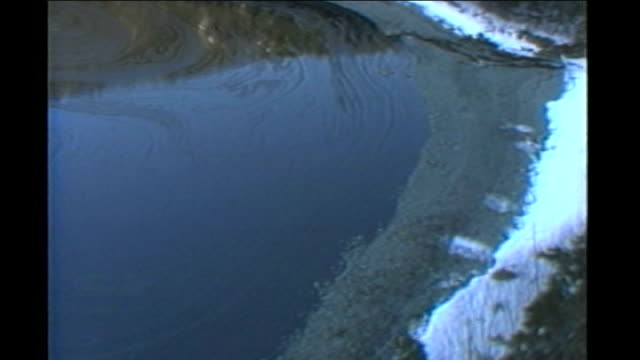 exxon oil disaster case begins at supreme court alaska prince william sound air views / aerials of exxon valdez oil spill and clean up operation... - oil spill stock videos & royalty-free footage