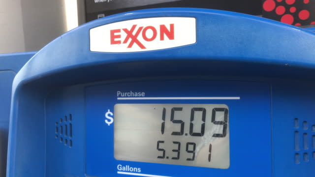 exxonmobil is an american multinational oil and gas corporation headquartered in irving texas - currency symbol stock videos & royalty-free footage