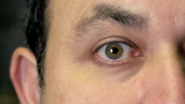 eye close up with cornea size changing  alpha channel included - eyelid stock videos and b-roll footage