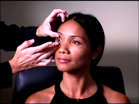 eye doctor putting contact lens in eye of patient - ophthalmologist stock videos and b-roll footage