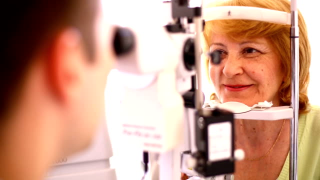 eye exam. - lens optical instrument stock videos & royalty-free footage