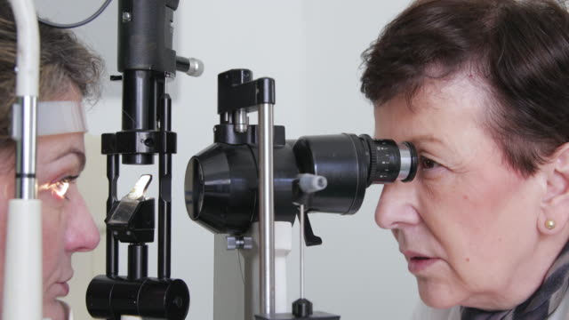 eye exam - lens optical instrument stock videos & royalty-free footage