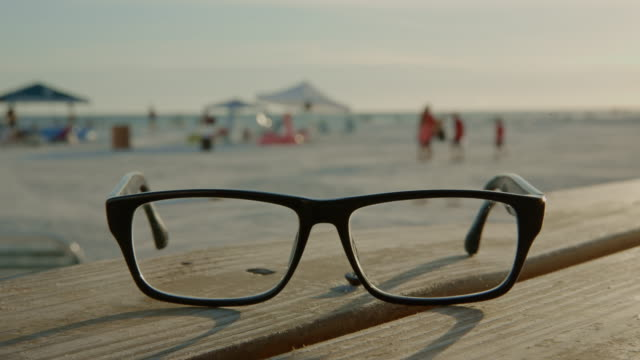 Eye glasses bench Florida beach people sunset summer