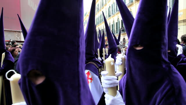 eye lets of the hooded nazarenos parade during the celebration of semana santa a holy week in malaga spain, europe - holy week stock videos & royalty-free footage