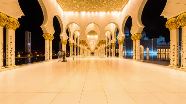 eye level view of dubai mosque interior night transition - arch stock videos & royalty-free footage