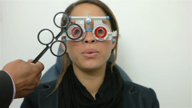 eye test in opticians - looking through an object stock videos and b-roll footage