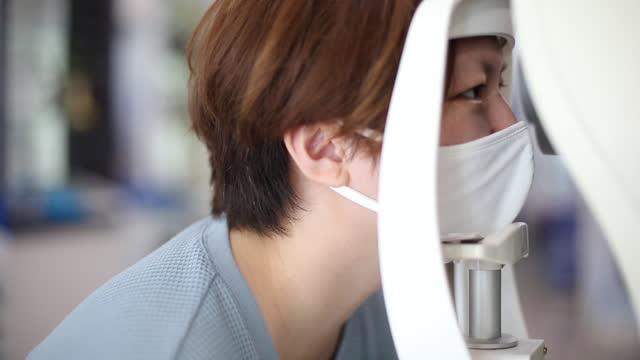eye test - lens optical instrument stock videos & royalty-free footage